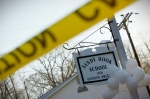 Balloons hang from the Sandy Hook Elementary School sign in Sandy Hook, in Newtown,