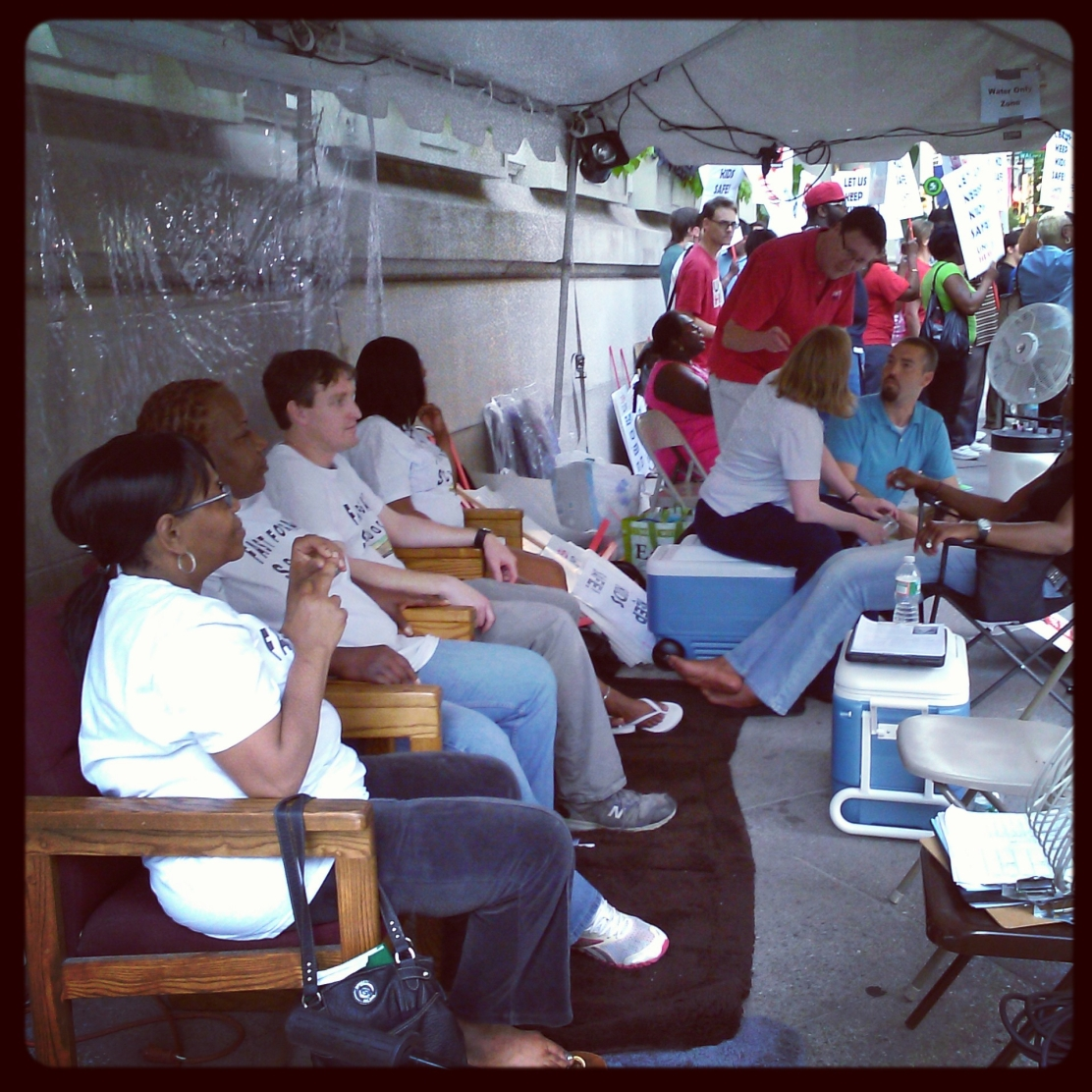 Hunger strikers seated outside of Governor Corbett's Philadelphia office.