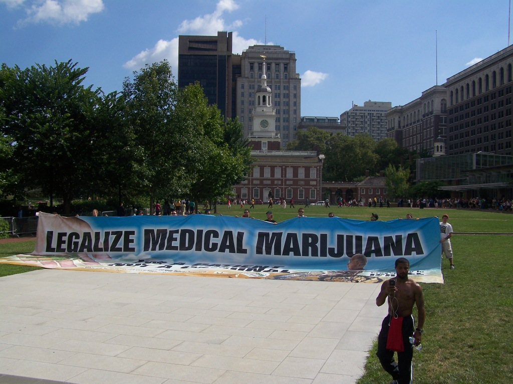 Mike Whiter of PA Veterans for Marijuana Legalization marshalled the waving of this enormous banner. Photo by Kenneth Lipp