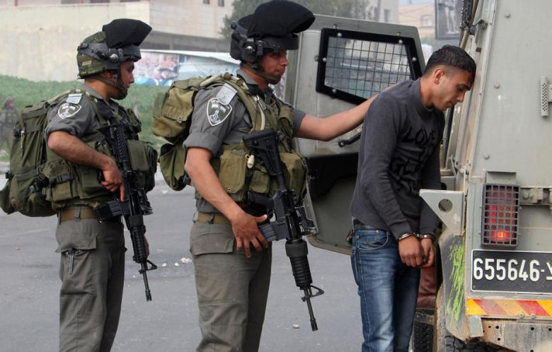 Palestinian protester detained by IDF soldiers. Photo: AFP - Jaafar Ashtiyeh