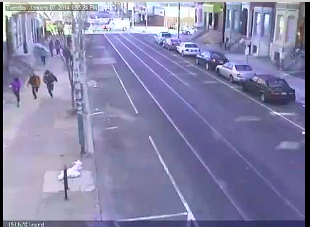 Manning, teammates running down Girard - the PPD van can be seen in the intersection in the distance