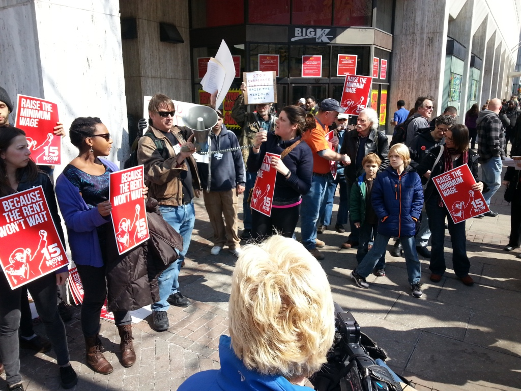 """15 Now Philly"" activists rally outside a K-Mart at 10th and Market."