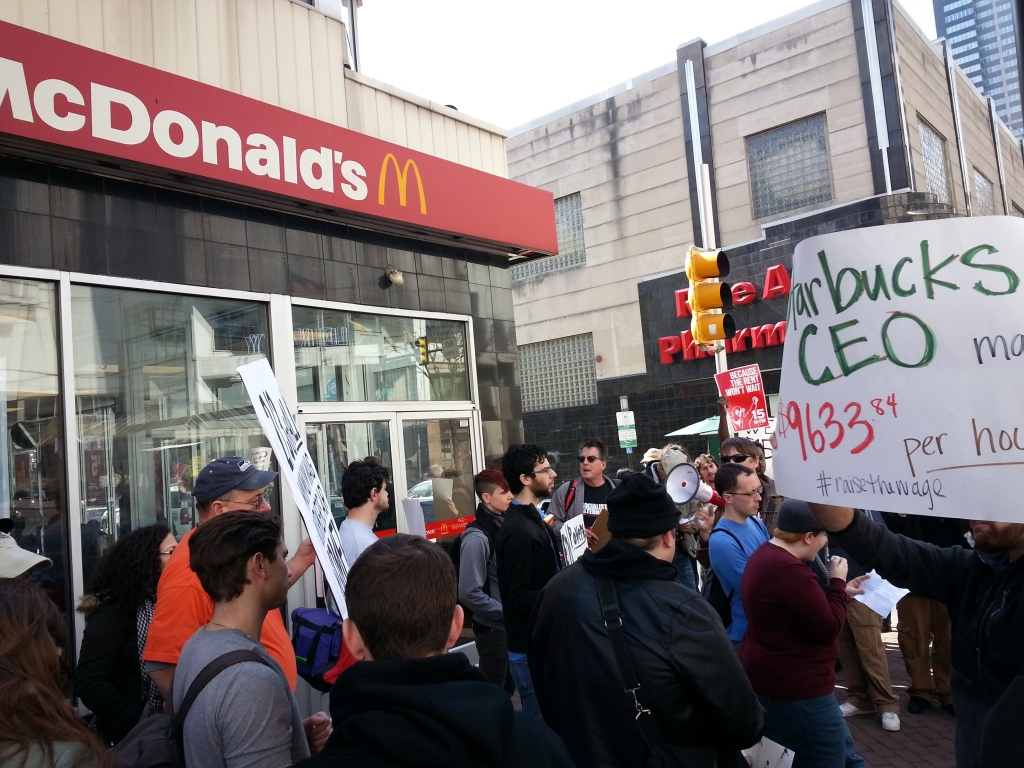 Activists rally outside a McDonald's restaurant in Center City. Photo: Dustin Slaughter