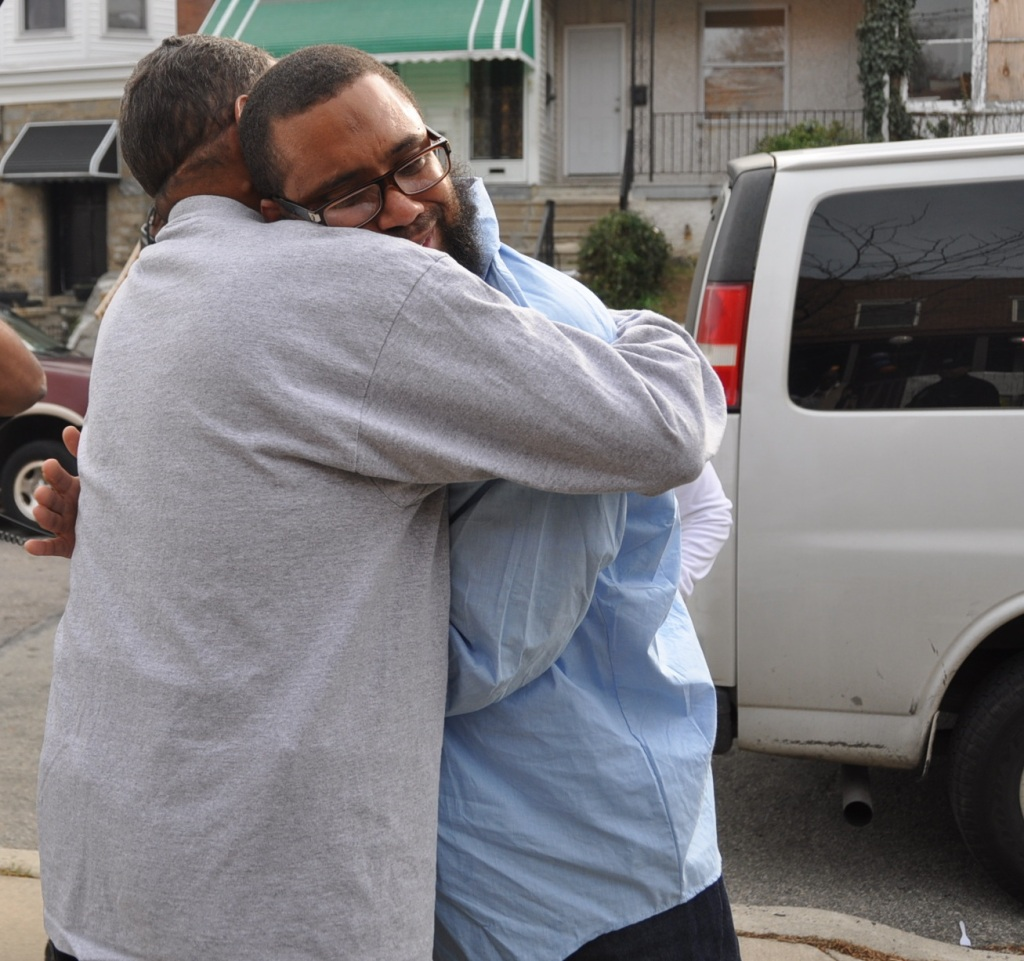 Eugene Gilyard hugs his father after returning home on November 18th, 2013. Gilyard was wrongfully convicted in 1995 and spent 15 years in prison. Photo: PA Innocence Project