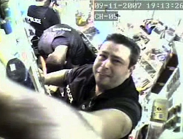 "A surveillance shot of the ""Tainted Justice"" cops robbing a bodega."