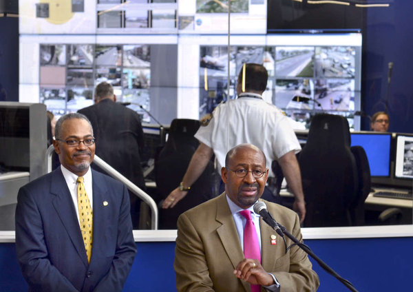 Mayor Michael Nutter and Deputy Mayor Everett Gillison at the Real Time Crime Center. Photo: Philly.com