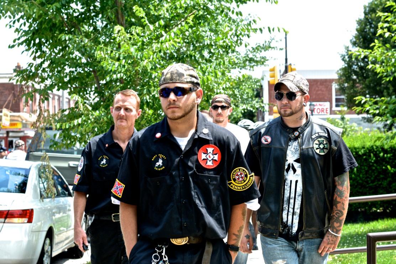 KKK members escorted from library. Photo by Joshua Albert