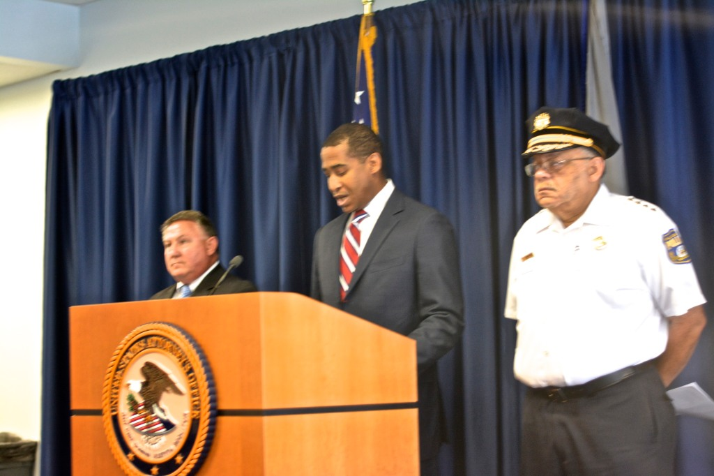Assistant US Attorney Anthony Wzorek announces charges against Philadelphia narcotics officers. (Right: Police Commissioner Charles Ramsey; Left: FBI Special Agent-in-Charge Edward Hanko. Photo: Joshua Albert