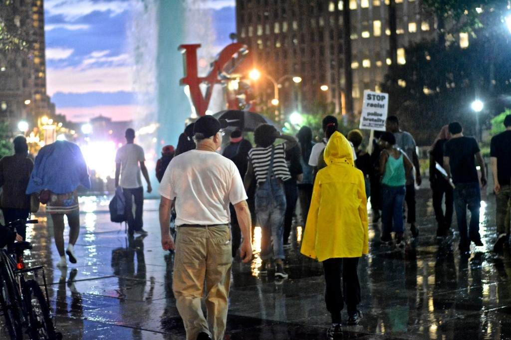 Protesters return to LOVE Park after rain subsides. ( Photo By Joshua Albert)