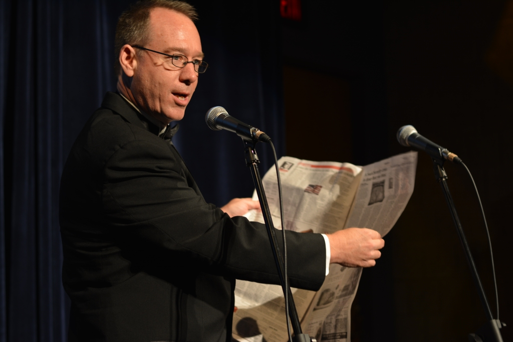 Joel Hodgson demonstrates how to boot up a newspaper. Photo by Kenneth Lipp