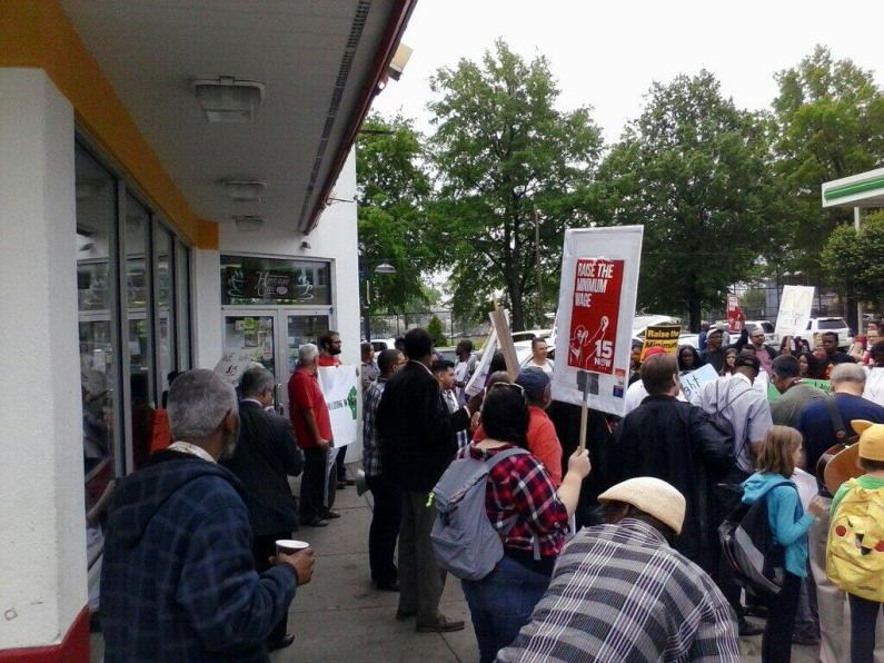 Striking fast food workers block the entrance to the McDonald's on Broad St. at Girard Avenue, May 15, 2014. Photo by Kenneth Lipp