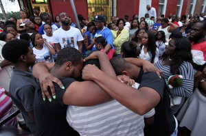 Friends and family members gathering on Hicks Street near West Bristol Street in the Nicetown section of Philadelphia on Sunday, Aug. 3, 2014, hold a vigil to remember Terrance 'T-Bird' Cox. Cox was fatally wounded on Thursday July 31, 2014, when unknown gunmen opened fire on the corner and critically wounded two other men. (GunCrisis.org, Joseph Kaczmarek)