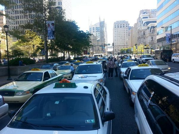 Cab drivers protest Uber by blockading part of JFK Boulevard on 8 October 2014. Photo: Tom MacDonald/Newsworks
