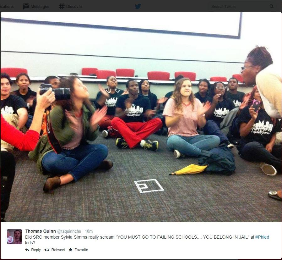 Commissioner Simms yelling at children during last night's sit-in. Photo via Raging Chicken Press