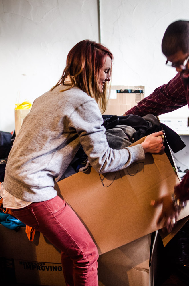 Carl Williams from North East Centers picks up donated clothes to be distributed to the needy. Photo By Joshua Albert