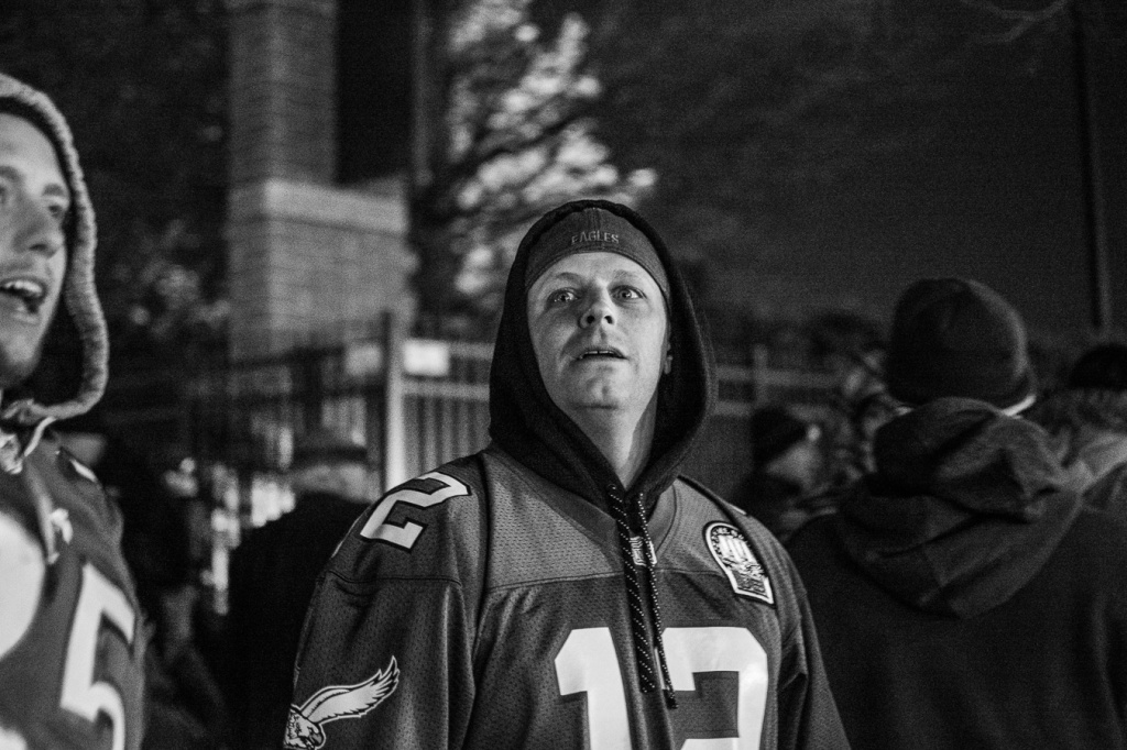 An inebriated Eagles fan heckles demonstrators. Photo by Joshua Albert