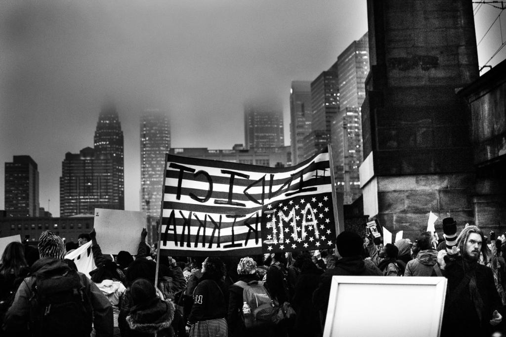 Demonstrators march down Market Street towards City Hall. Photo: Joshua Albert