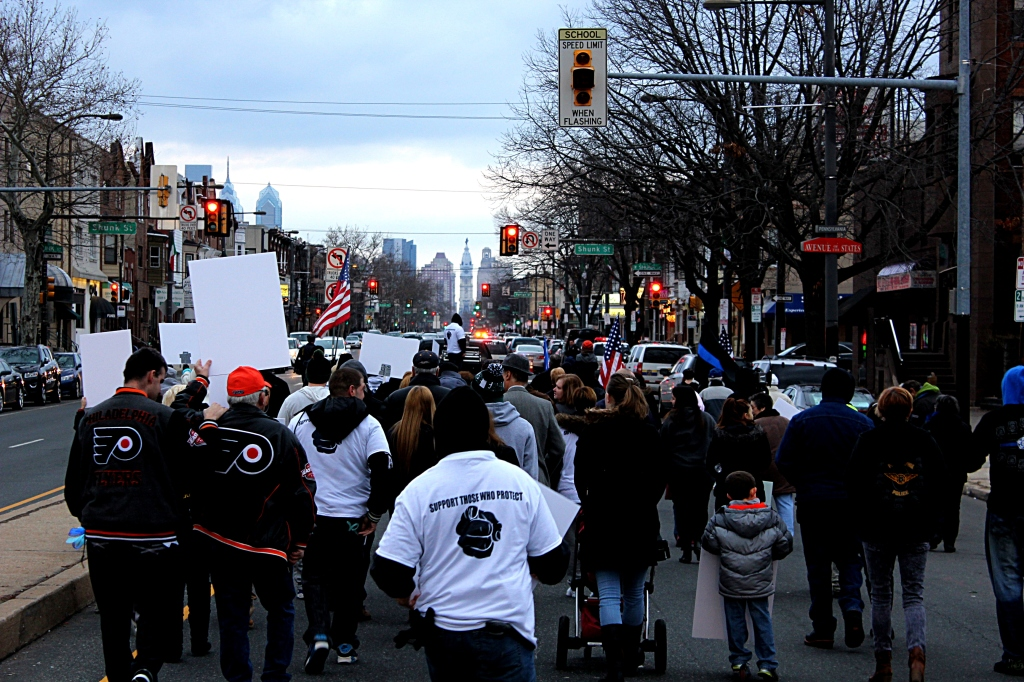 The group of marchers begins north toward City Hall from Oregon avenue around 4:45 Sunday afternoon. Photo by Kenneth Lipp
