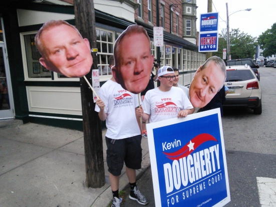 IBEW 98 members with Kevin Dougherty and Jim Kenney heads outside of the Famous 4th Street Deli this morning. Photo by Kenneth Lipp