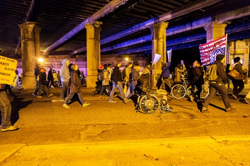Protesters walk beneath overpass on Wednesday night. Photo by Thomas Weir