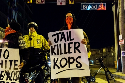 """Jail Killer Cops"" sign at Wednesday night's protest. Photo by Thomas Weir"