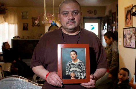 Carmelo Santiago with a photo of his son Carmelo Winans, shot by Philadelphia police on March 13th, 2011. Courtesy of the Philadelphia Inquirer.