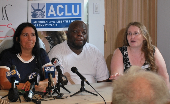 Members of PPEHRC and ACLU-PA Deputy Director Mary Catherine Roper address media at a press conference. /Jack Grauer
