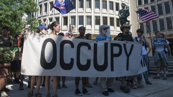 Occupy activists march through the streets of Philadelphia, PA July, 2, 2012. (Mannie Garcia/MintPress)